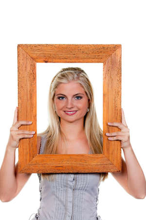 framed: Young woman looks through a picture frame.