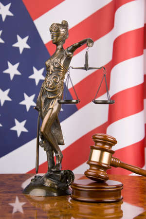 court proceedings: A gavel in court. With an American flag in the background. Stock Photo