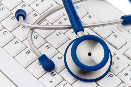 A stethoscope in a hospital is on your computer keyboard. Stock Photo - 7939607