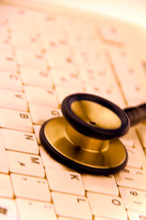 schedule reports: A stethoscope in a hospital is on your computer keyboard.