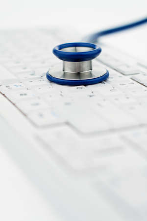 A stethoscope in a hospital is on your computer keyboard. photo