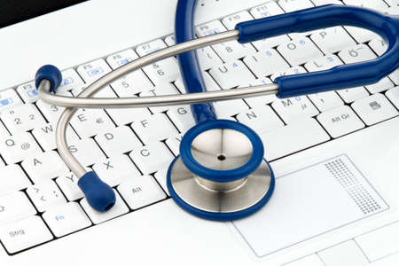 medical bills: A stethoscope in a hospital is on your computer keyboard.