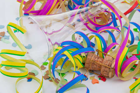 prickling: Empty champagne glass, and garlands of the carnival Stock Photo