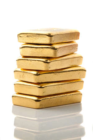 gold bullion: Investment in real gold than gold bullion and gold coins. Feingold. Stock Photo