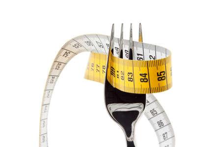 dieting: Instellen met tape maatregel. Symbool voor dieet en gewichtsverlies.