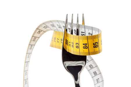 dieting: Set with tape measure. Symbolic for diet and weight loss.