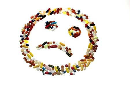 generic drugs: Un volto con un cattivo umore da tavolette formata. Archivio Fotografico