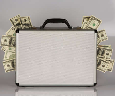 budgets: Money case with many U.S. dollars banknotes. Crime in the economy
