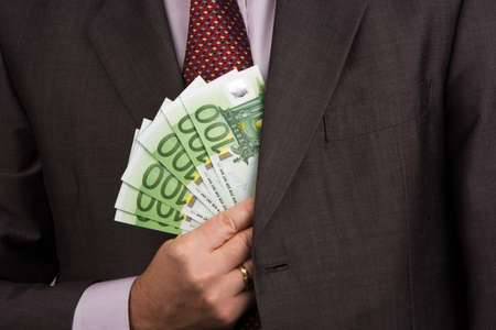 bribes: Manager and business executive with Euro money. Image for income. Stock Photo