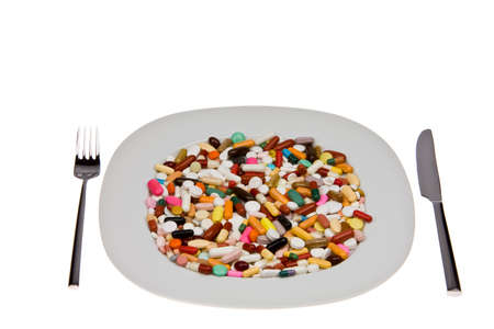 generic drugs: Many different tablets and medicines are on plate Stock Photo