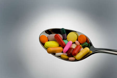 Many different tablets and medicines are on a spoon Stock Photo - 7993773