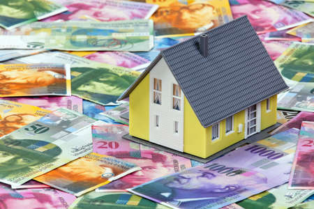 housing crisis: Financing a home in Swiss francs. Credit risk in foreign currency. Stock Photo