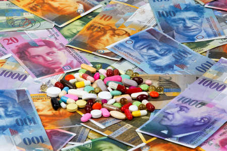 generic drugs: Swiss francs and tablets as a symbol of health costs Stock Photo