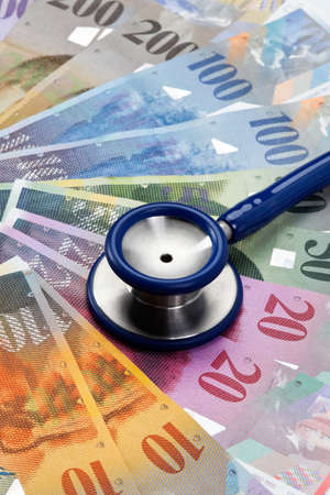 seem: Swiss francs and stethoscope as a symbol of health costs