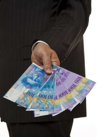 bribes: Manager, Swiss franc banknotes in his hand