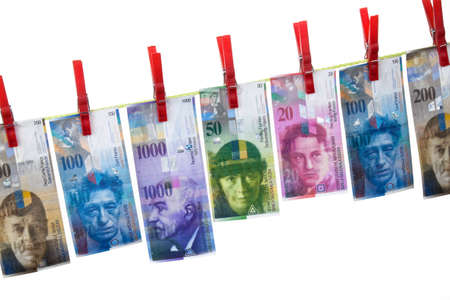 laundering: Clothesline with Swiss francs. Image of money laundering Stock Photo