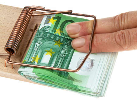mousetrap: Mousetrap with ? bills. Image debts and loans. Stock Photo
