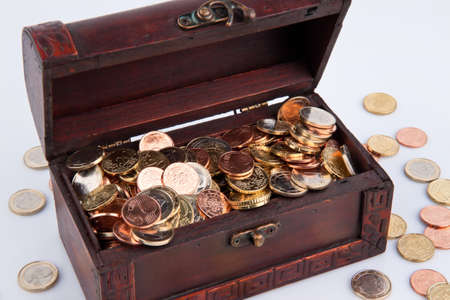 insolvent: ? treasure chest with coins. Isolated on white background. Stock Photo