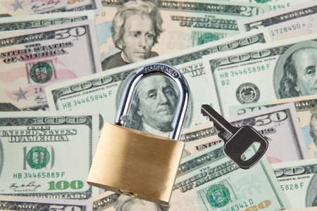 Dollar Currency notes with lock and chain. Money stack for safety and investment. Stock Photo - 7993756