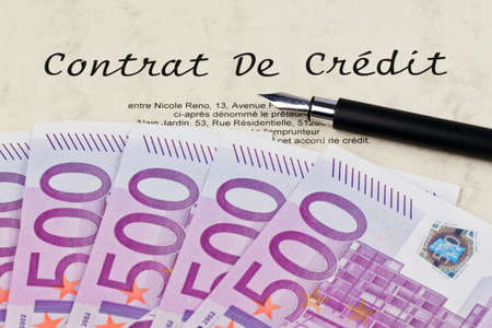 Many Euro bank notes and credit agreement (French) photo