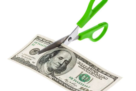 rescheduling: Dollar Currency notes and scissors. Duties and taxes. Stock Photo
