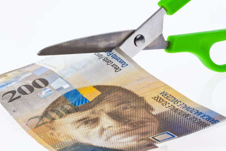 seem: Swiss franc note with scissors. Currency of Switzerland.