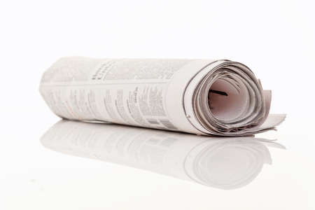and lies: A newspaper lies on a white background