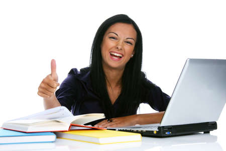 Young and successful woman has joy and fun with laptop computer photo