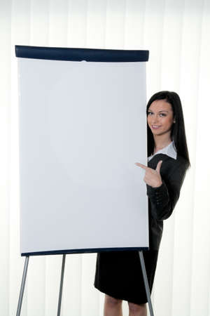 flipchart: Coach before empty flipchart on education and training Stock Photo