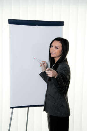 Coach before empty flipchart on education and training Stock Photo - 8007249