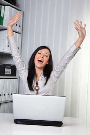 clerical: Young and successful woman has joy and fun with laptop computer