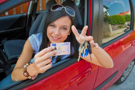novice: Young woman with new car and car keys