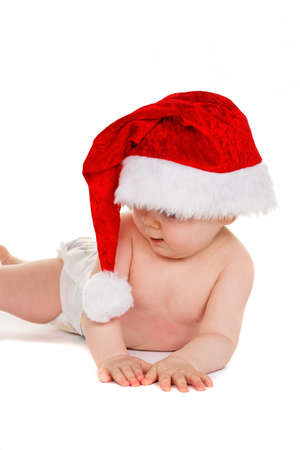 Small child with Baby Santa Claus hat isolated on white background photo