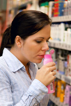 local supply: Young woman in a drug store at shopping