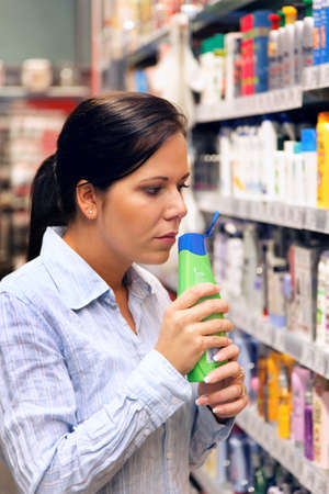 household money: Young woman in a drug store at shopping