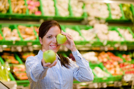 local supply: Young woman buys in the supermarket food and fruit. Stock Photo
