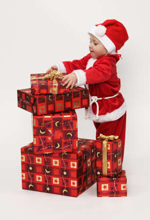 christmas dish: Little girl (child) as Santa Claus. With Christmas gifts