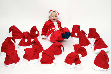 free dish: Little girl (child) as Santa Claus. With Christmas gifts