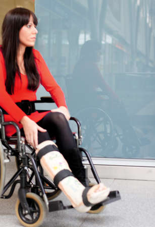 plaster leg cast: Young woman with a leg cast and wheelchair in the hospital