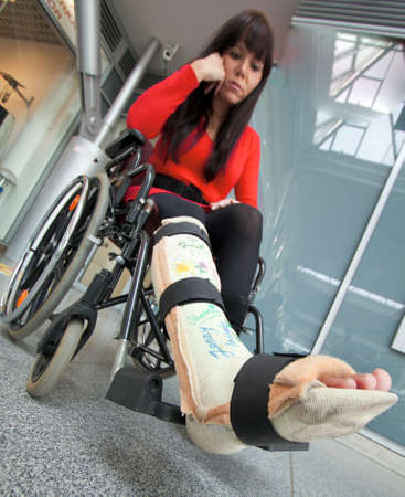 Young woman with a leg cast and wheelchair in the hospital Stock Photo - 8007559