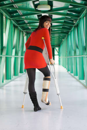 Young woman with a leg cast and crutches in hospital photo