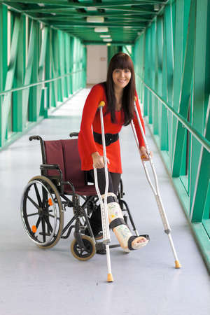 crutches: Young woman with leg cast Stock Photo