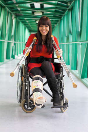 Young woman with a leg cast and wheelchair in the hospital