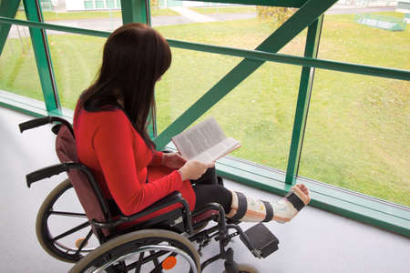 Young woman with a leg cast and wheelchair in the hospital Stock Photo - 8007628