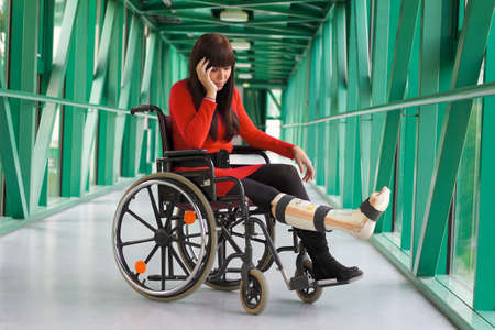 Young woman with a leg cast and wheelchair in the hospital Stock Photo - 8007617