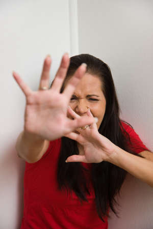 Young woman is afraid of violence in the family photo