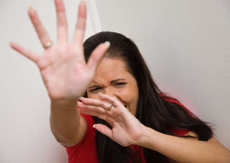 defensive posture: Young woman is afraid of violence in the family