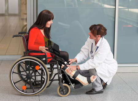 Young woman with a leg cast and wheelchair in the hospital Stock Photo - 8007624