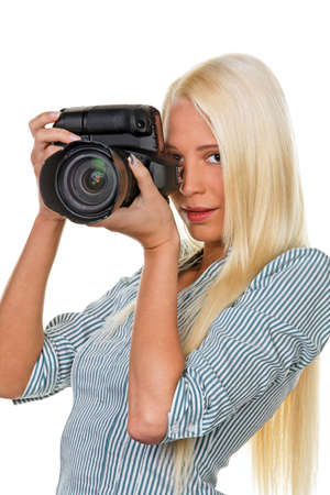apprenticeships: Young woman photographed with a digital SLR camera