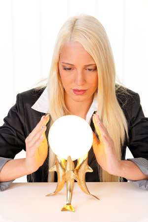 clairvoyance: Young woman indicated the future from a crystal ball in their hands